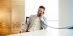 Photo of a man in a suit talking on the phone